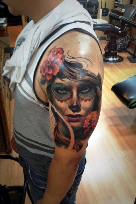 Mexican traditional colored shoulder tattoo of human face and flowers