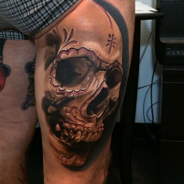 Mexican traditional colored thigh tattoo of human skull