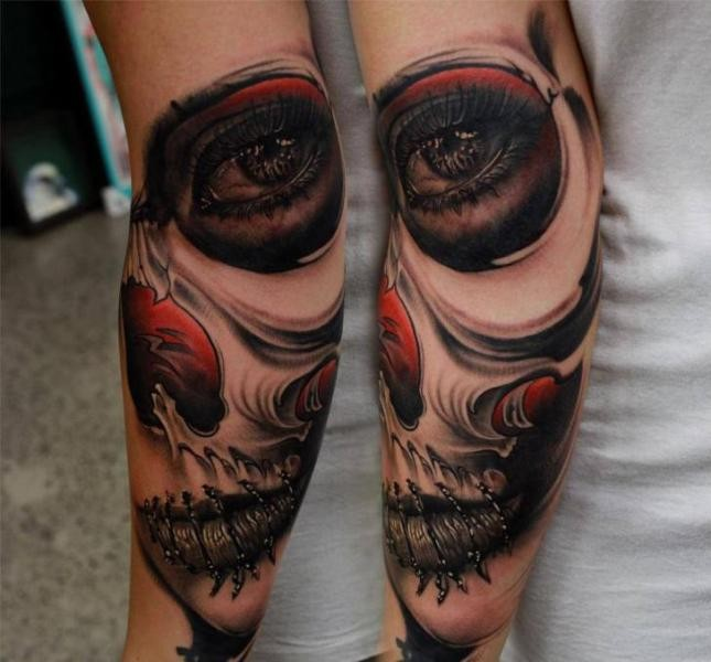 Mexican traditional style colored demonic woman tattoo on forearm