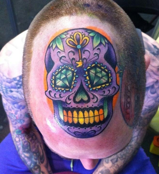 Mexican traditional style colored head tattoo of funny looking skull