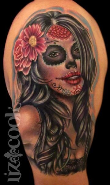 Mexican traditional style colored shoulder tattoo of woman portrait with flowers