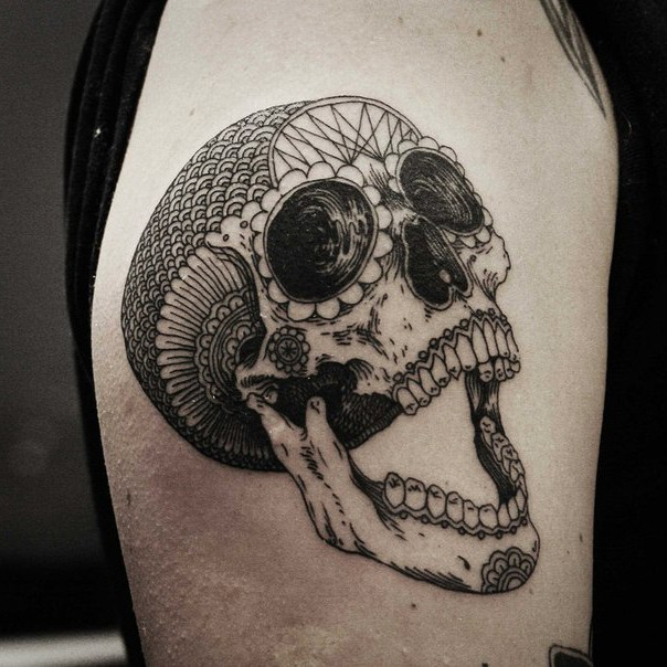 Mexican traditional style colored shoulder tattoo of big human skull with ornaments