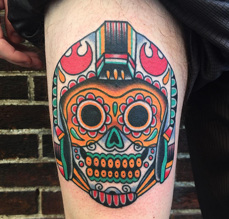 Mexican traditional style colored thigh tattoo of cute skull with helmet