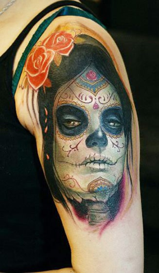 Mexican traditional style colorful shoulder tattoo of woman portrait and flower