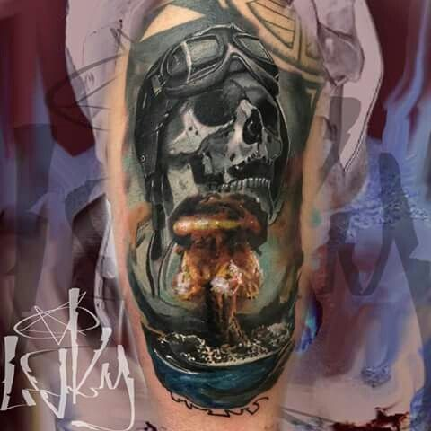 Military themed colored tattoo of nuke blast with human skull and helmet