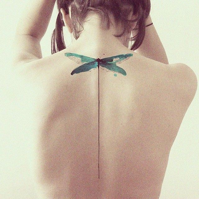 Minimalist green dragonfly tattoo on back for women