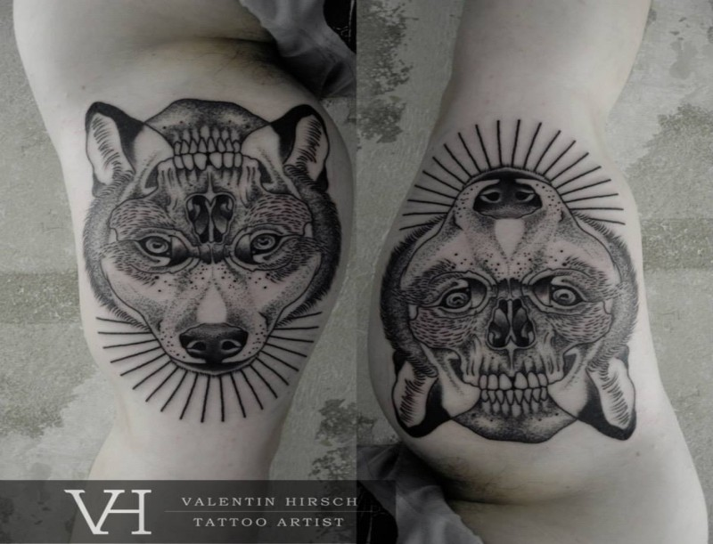 Mirrored dot style biceps tattoo of wolf head combined with human skull