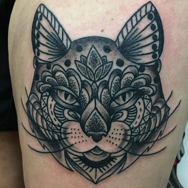 Modern dot style thigh tattoo of big cat mask with various ornaments