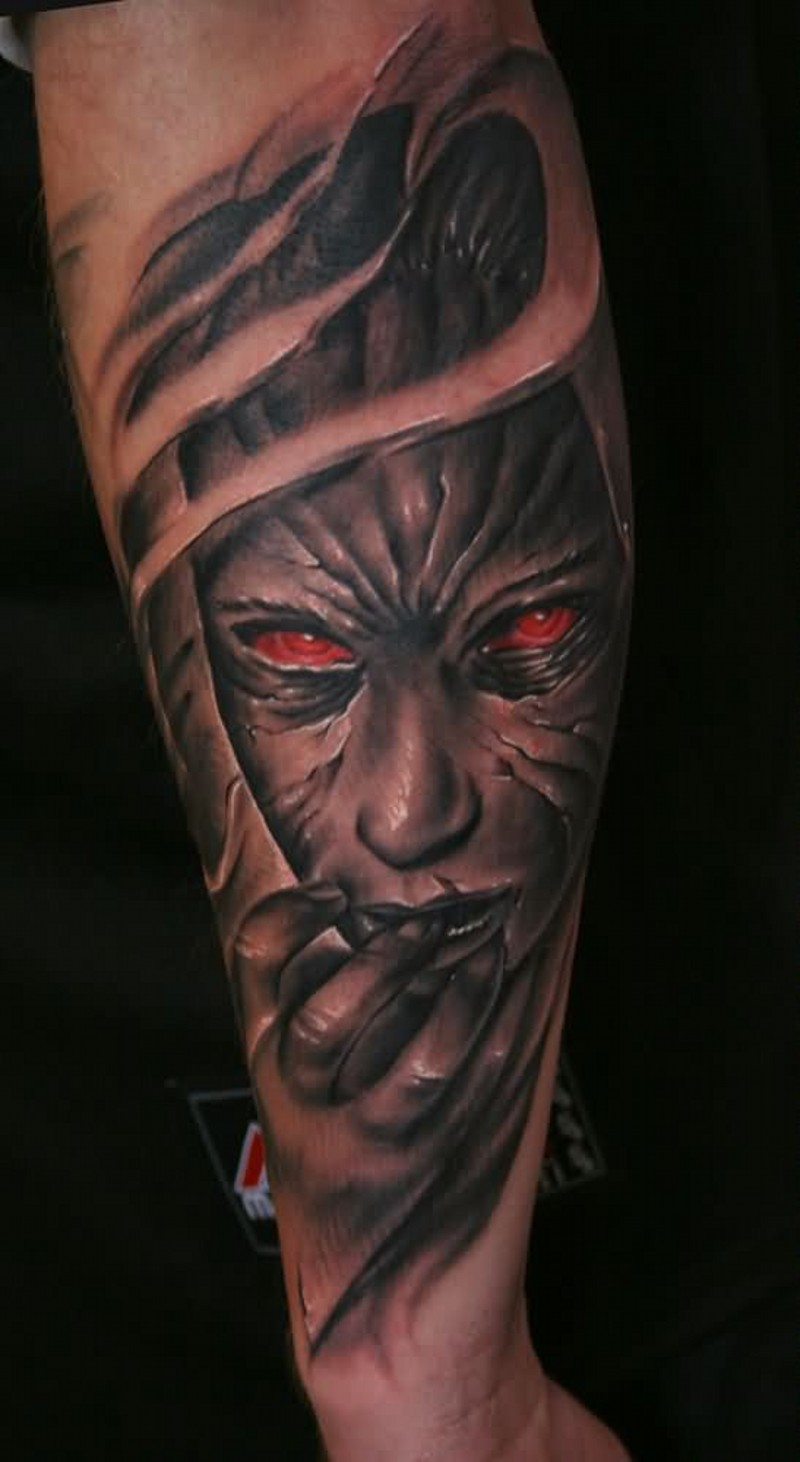 Modern horror movie themed colored forearm tattoo of monster woman portrait