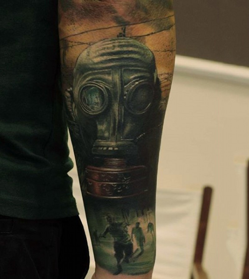 Modern military style colored forearm tattoo of gas mask and running zombies