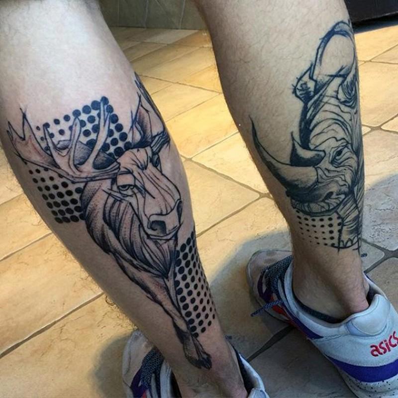 Modern style black ink leg tattoo of elk and rhino