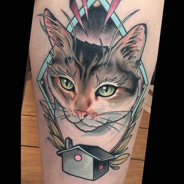 Modern style colored arm tattoo of beautiful painted cat with little house