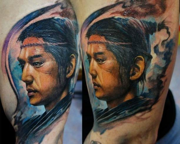 Modern style colored arm tattoo of Asian man portrait