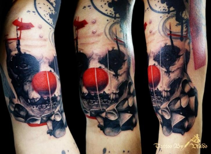 Modern style colored arm tattoo of clown maniac face