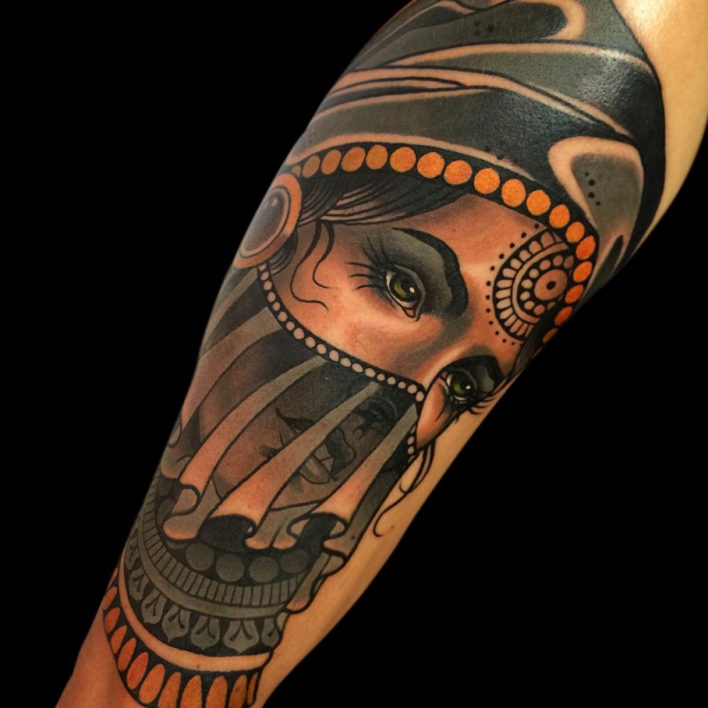 Modern style colored arm tattoo of woman portrait