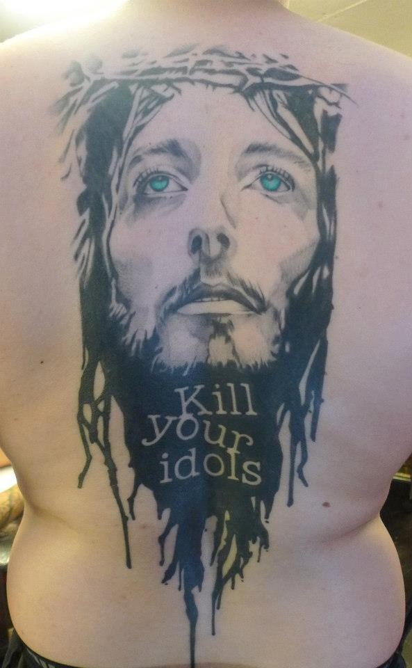 Modern style colored back tattoo of Jesus portrait with lettering