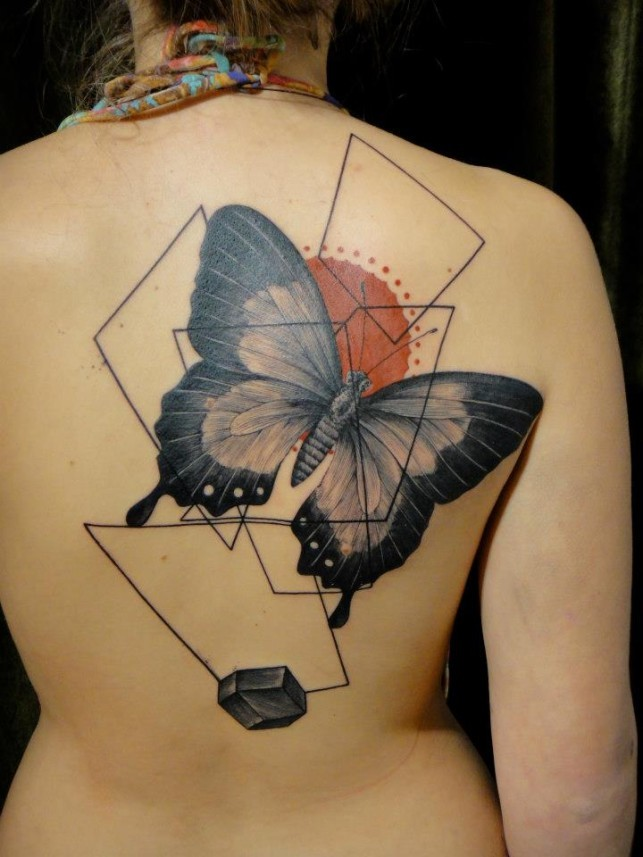 Modern style colored back tattoo of large butterfly with geometrical ornaments