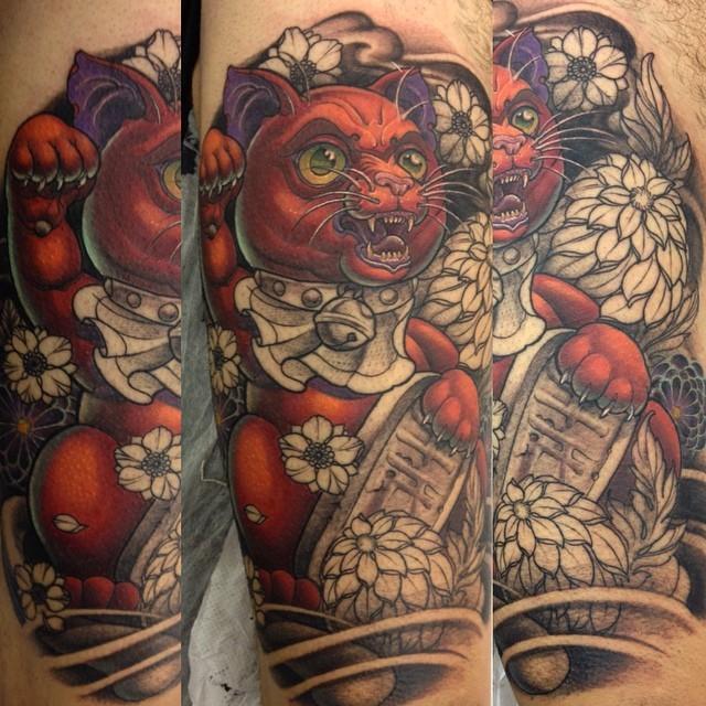 Modern style colored biceps tattoo of evil maneki neko japanese lucky cat with flowers