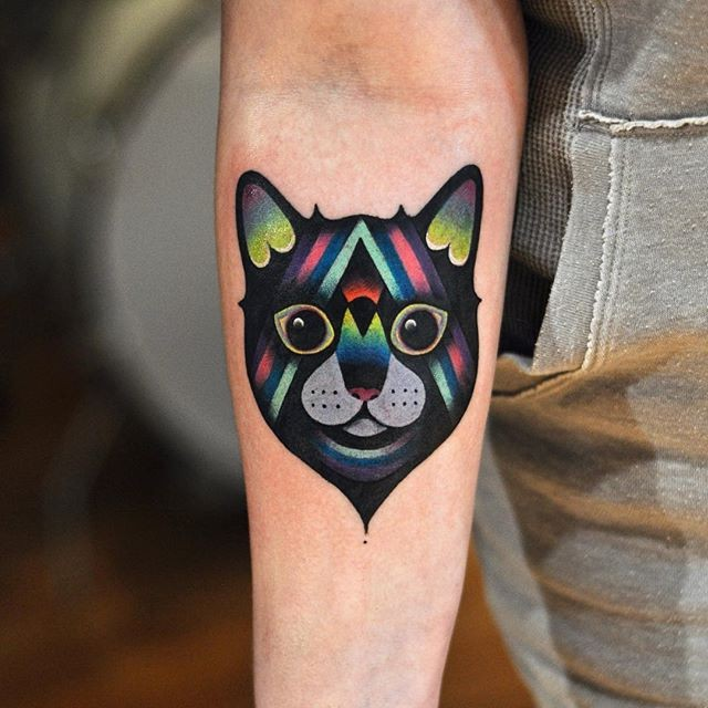 Modern style colored by David Cote forearm tattoo of smiling Cat