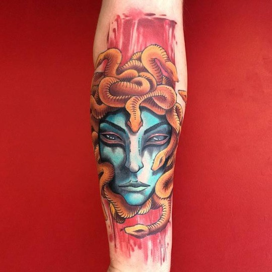 Modern style colored by Dino Nemec forearm tattoo of Medusa