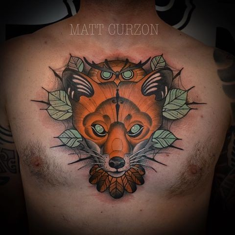 Modern style colored chest tattoo of creepy fox and leaves