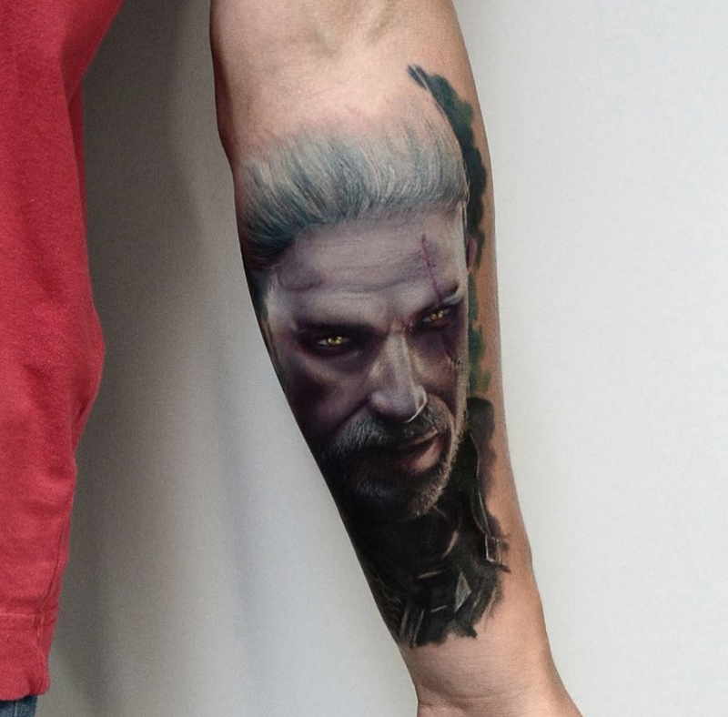 Modern style colored forearm tattoo of video game Witcher