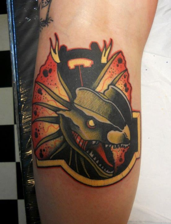 Modern style colored forearm tattoo of interesting snake shaped emblem