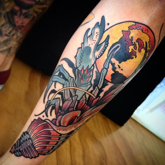 Modern style colored forearm tattoo of ocean crab with moon