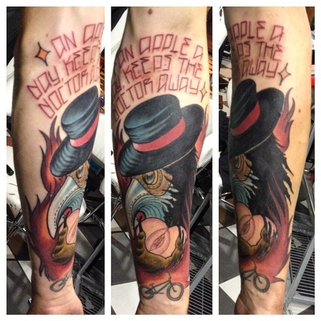 Modern style colored forearm tattoo of plague doctor with lettering