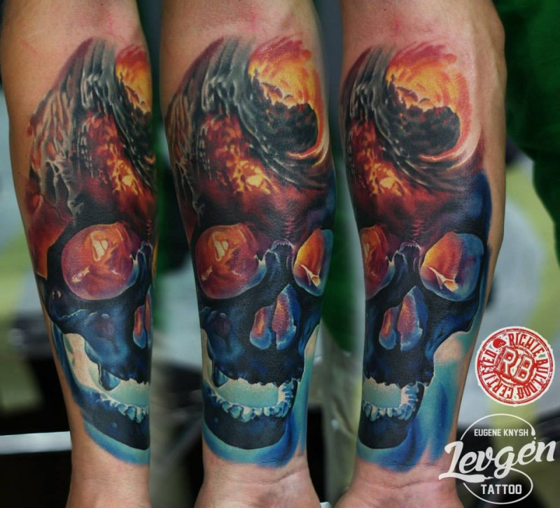 Modern style colored forearm tattoo of demonic human skull with burning vortex