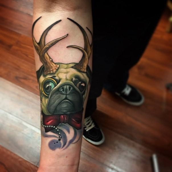 Modern style colored forearm tattoo of little dog with horns