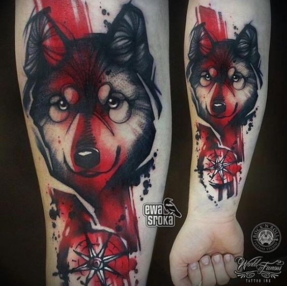 Modern style colored forearm tattoo of wolf head with compass