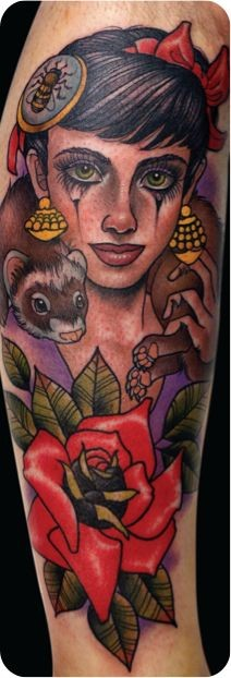 Modern style colored gypsy woman portrait tattoo on arm stylized with flowers and small animal