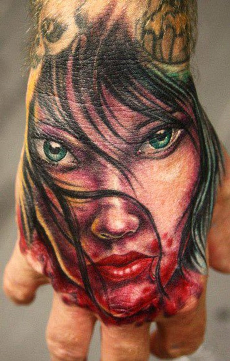 Modern style colored hand tattoo of bloody vampire woman