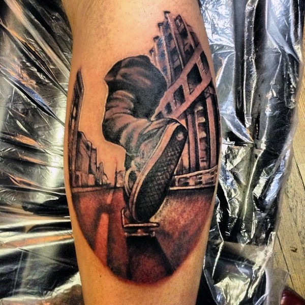 Modern style colored leg tattoo of skater