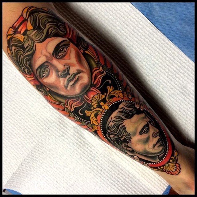 Modern style colored leg tattoo of woman portrait with old mans portrait