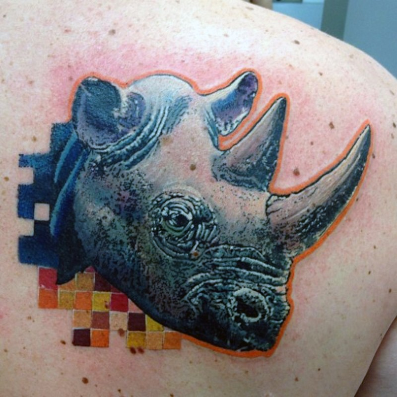 Modern style colored shoulder tattoo of rhino head and mosaics