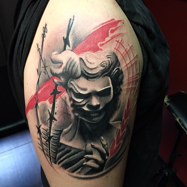 Modern style colored shoulder tattoo of creepy woman with barbed wire
