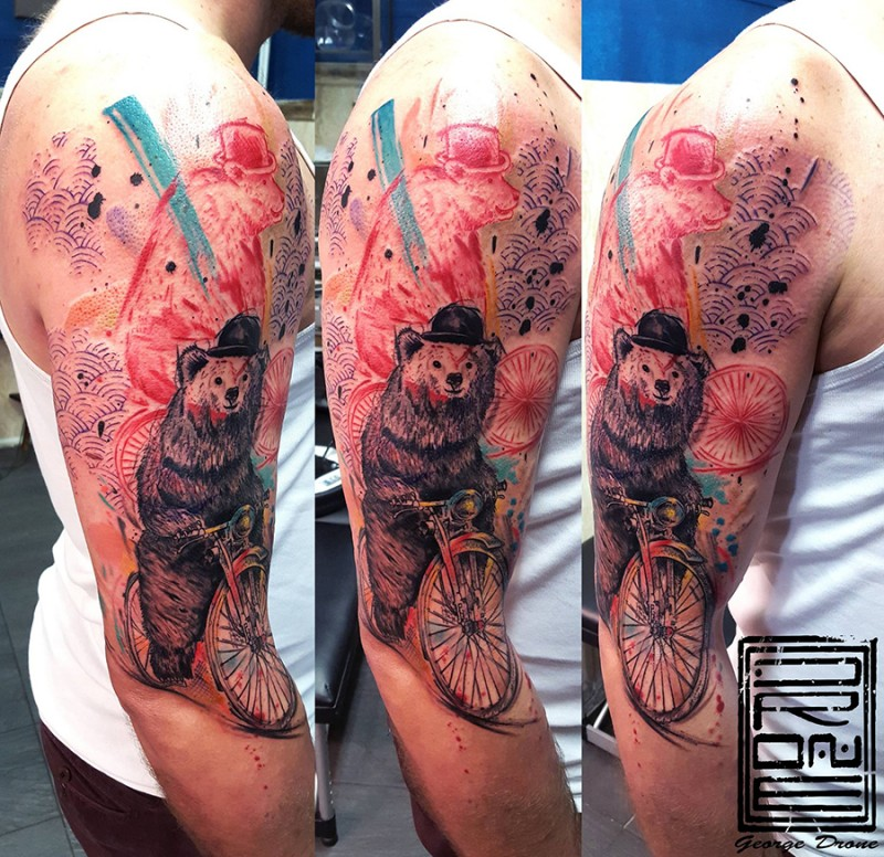 Modern style colored shoulder tattoo of funny bear riding bicycle