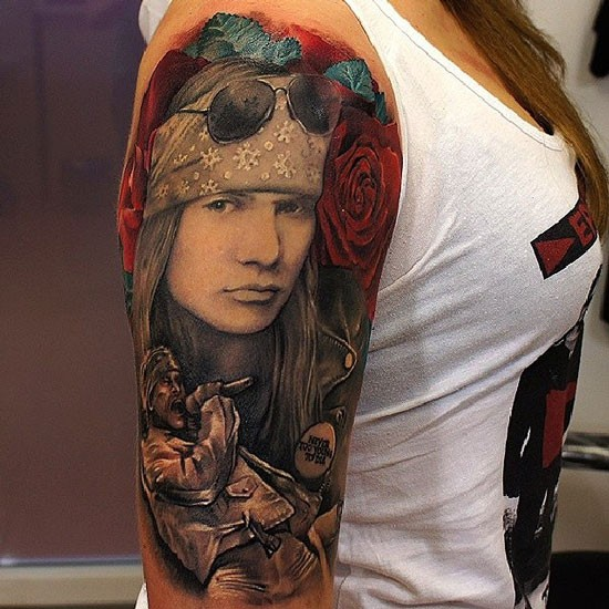 Modern style colored shoulder tattoo of Guns n Roses front man