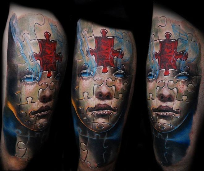 Modern style colored thigh tattoo of fantasy woman face with puzzle pice