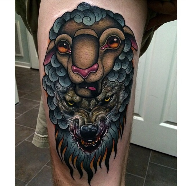 Modern style colored thigh tattoo of evil wolf with sheep