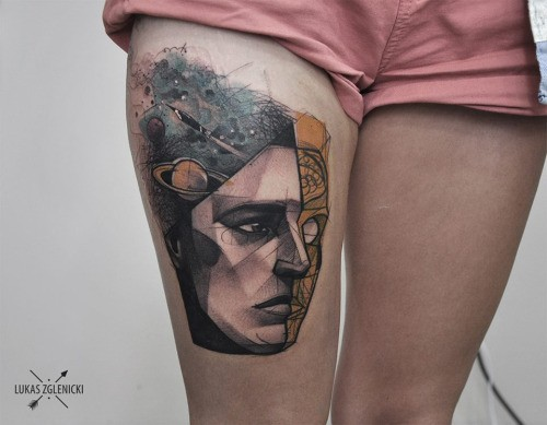 Modern style colored thigh tattoo of human face with planets