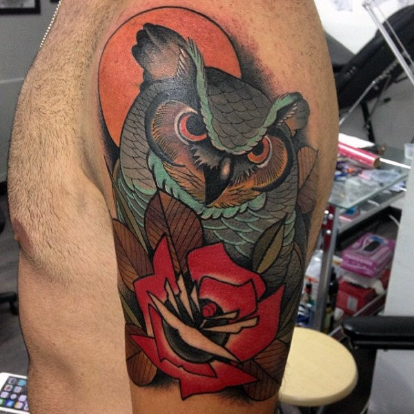 Modern style colored upper arm tattoo of big owl with rose and sun