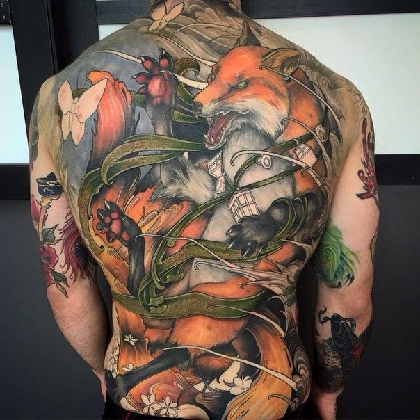 Modern style colored whole back tattoo of fox warrior with butterflies