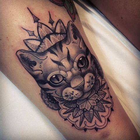 Modern style detailed tattoo of mysterious cat with various floral ornaments