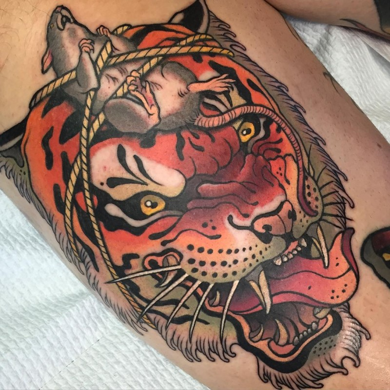 Modern style interesting looking colored tattoo of evil tiger head with roped mouse