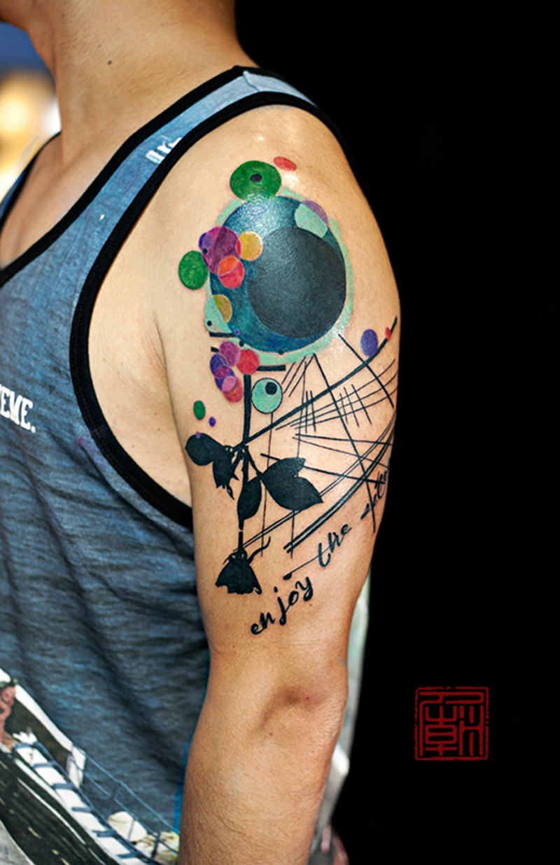 Modern style multicolored flower shaped shoulder tattoo combined with lettering