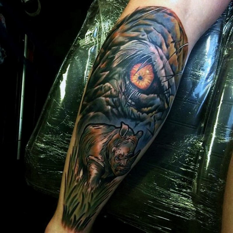 Modern style painted and colored big leg tattoo of rhino in wild life