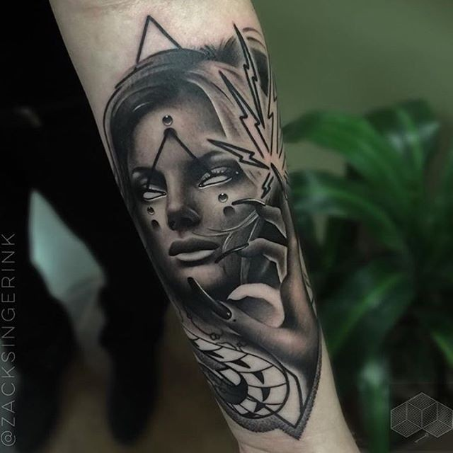 Modern traditional black and white forearm tattoo of woman with long nails and mystic symbols